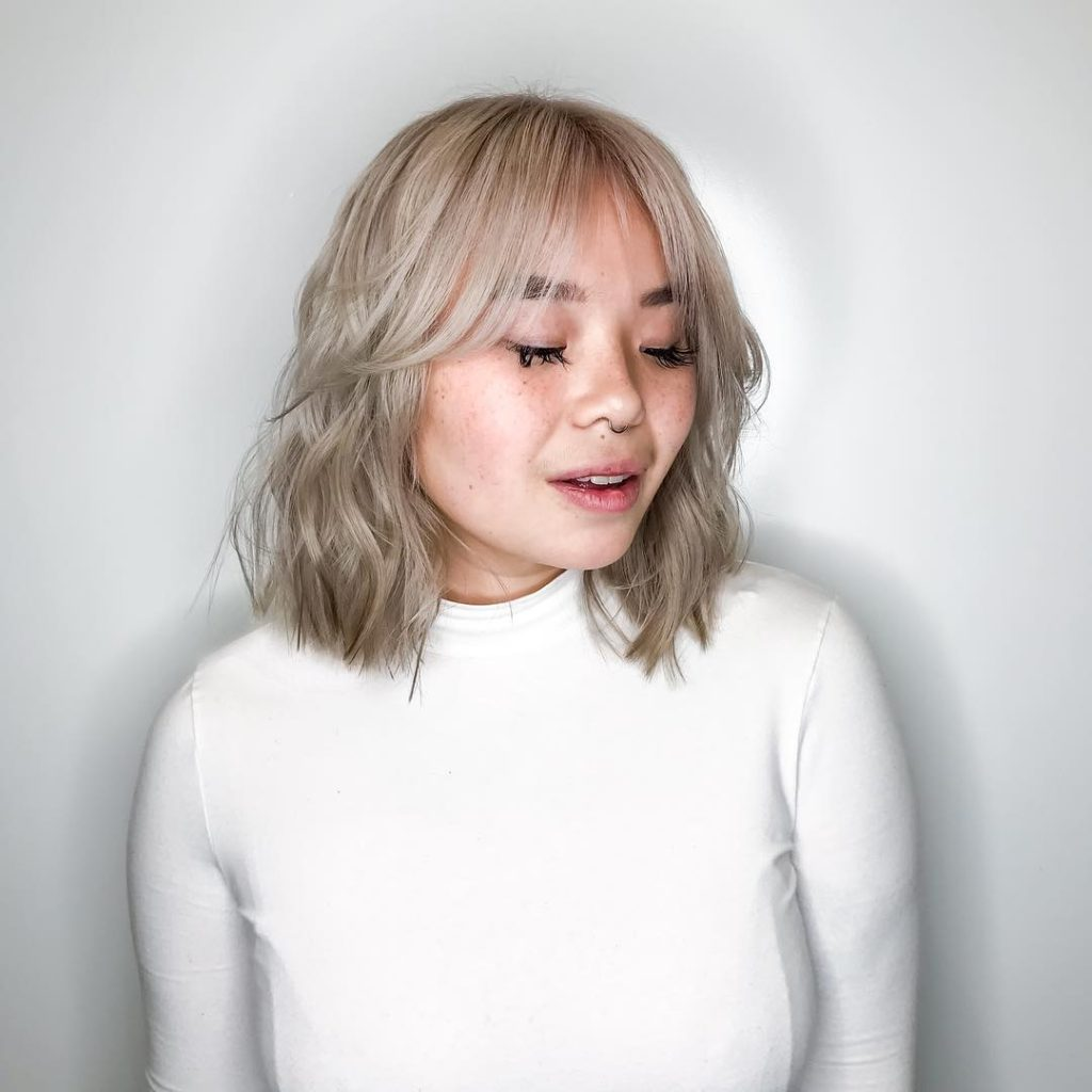 Platinum Wavy Bob with Seamless Layers and Curtain Bangs Medium Length Hairstyle