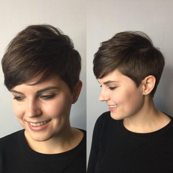 Polished Tapered Pixie with Voluminous Texture and Side Swept Bangs on Brunette Hair Short Hairstyle