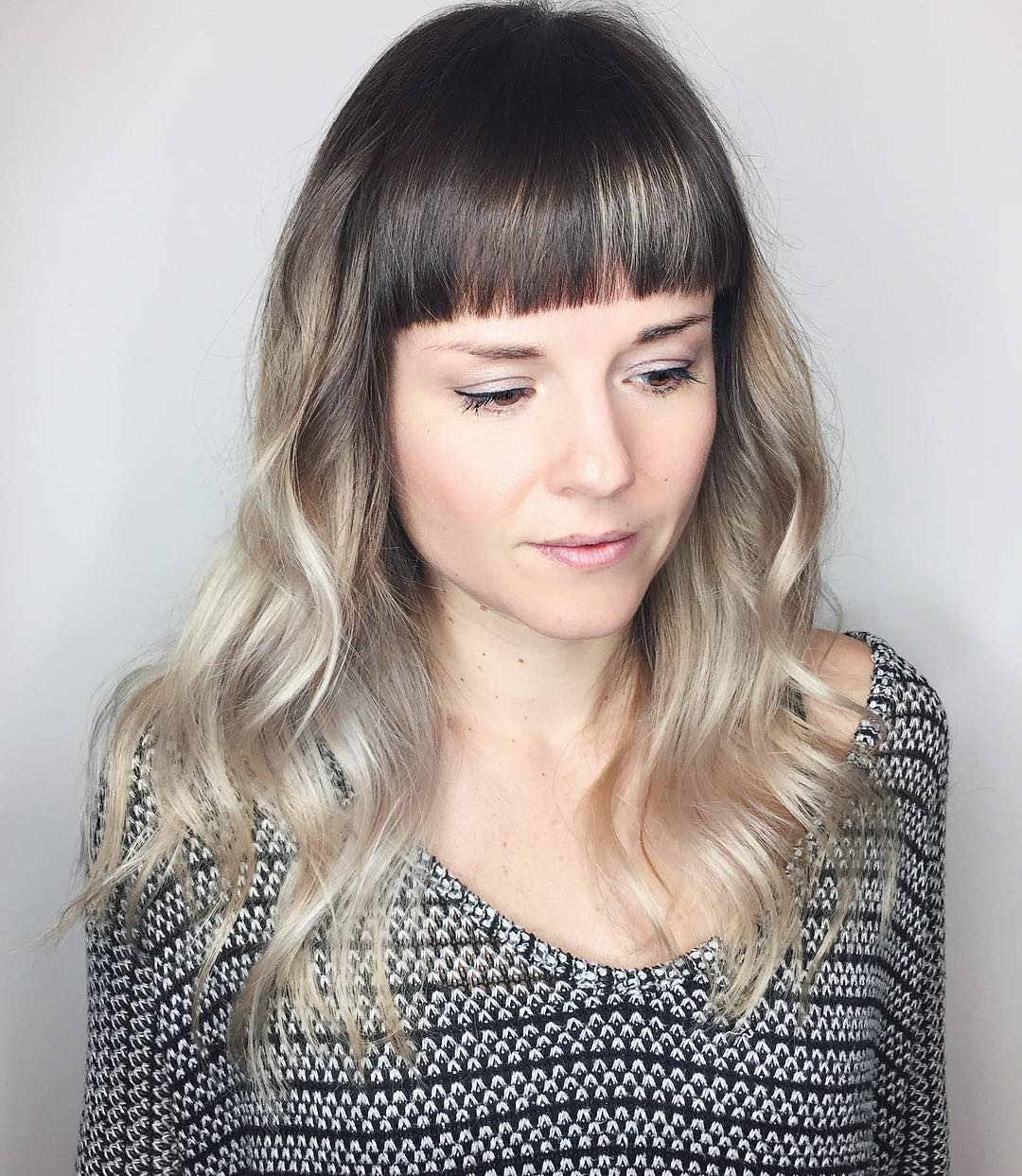 Polished Wavy Layered Cut with Blunt Baby Bangs and Cool Blonde Color Melt Long Hairstyle