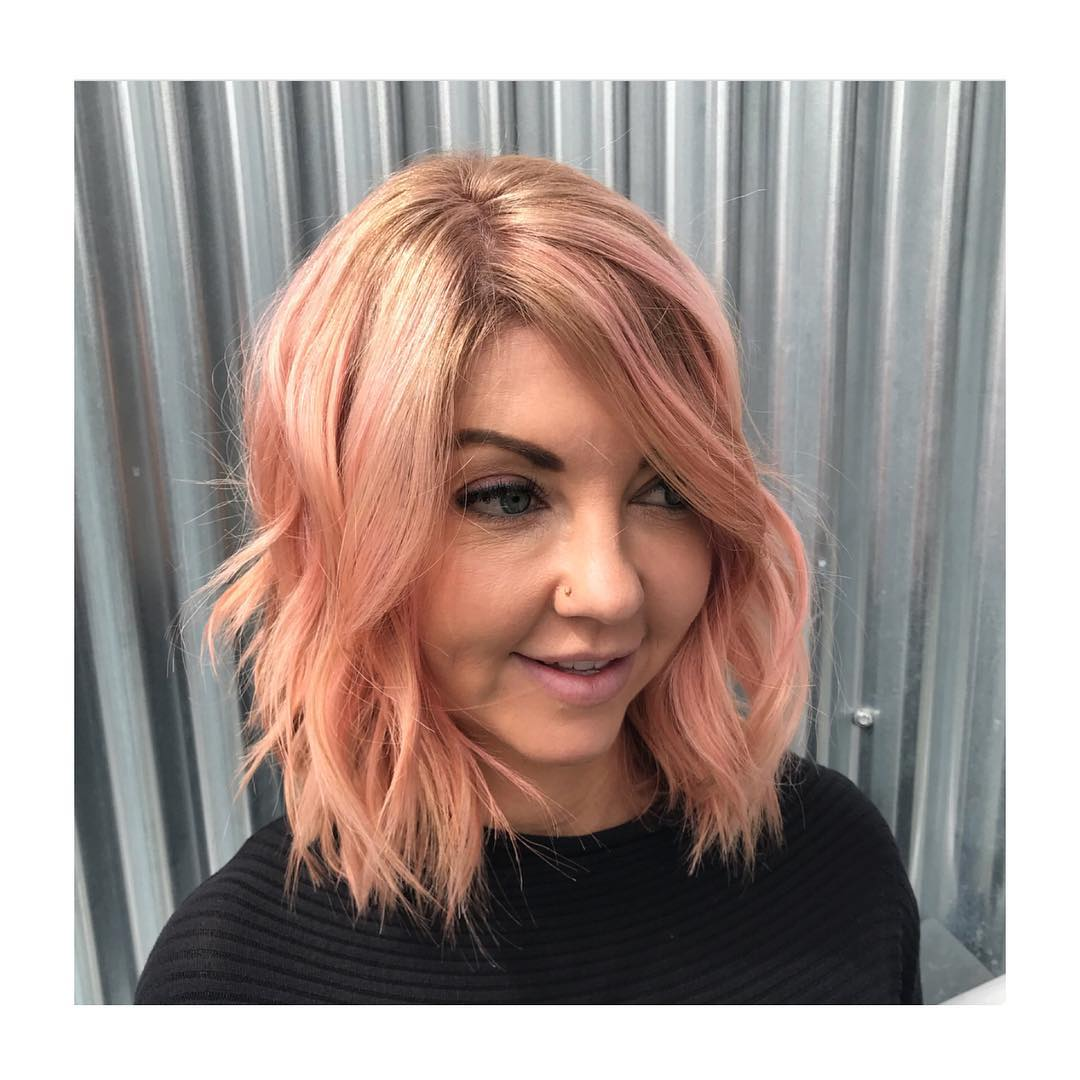Rose Gold Bob with Long Side Swept Bangs and Messy Beach Waves Texture Medium Length Hairstyle