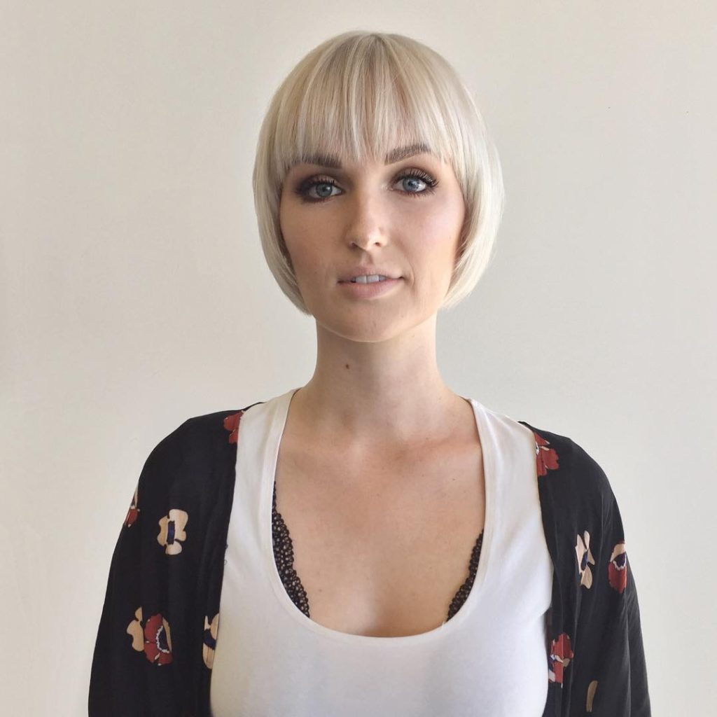 Rounded Face Framing Bob with Fringe Bangs and Platinum Color Short Hairstyle