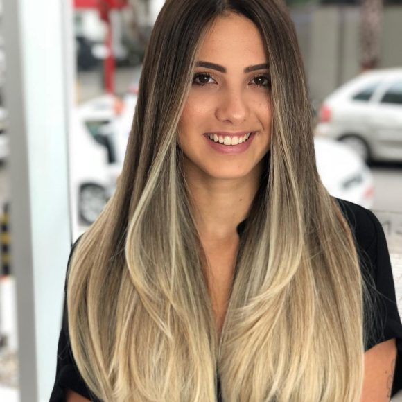 Sexy Layered Cut with Bombshell Blowout Texture and Brown to Blonde Color Melt Long Summer Hairstyle