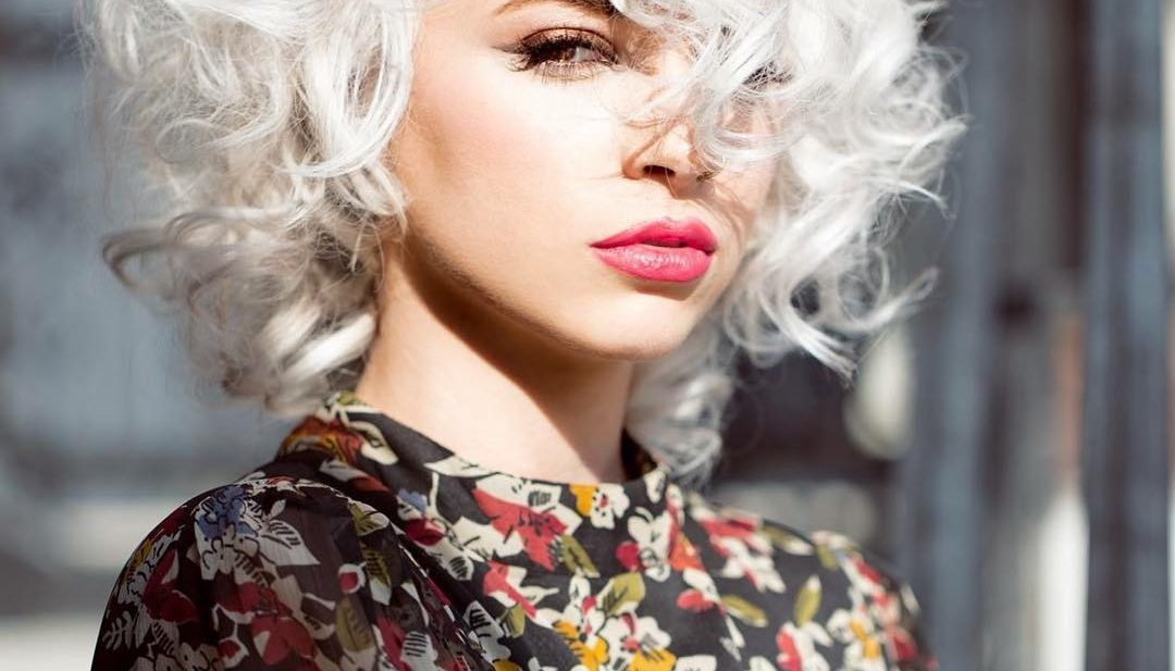Sexy Platinum Mod Bob with Allover Messy Curly Texture and Long Side Swept Curly Bangs Medium Length Retro Fall Hairstyle