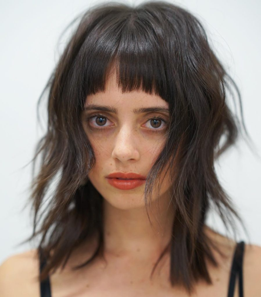 Shaggy Brunette Fringe Cut with Messy Wavy Beach Texture and Bangs Medium Length Summer Hairstyle