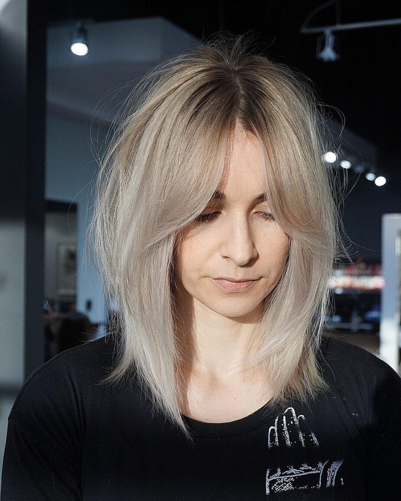 Shaggy Curtain Banged Lob With Undone Straight Texture And Platinum Blonde Color Medium Length Hairstyle The Latest Hairstyles For Men And Women 2020 Hairstyleology