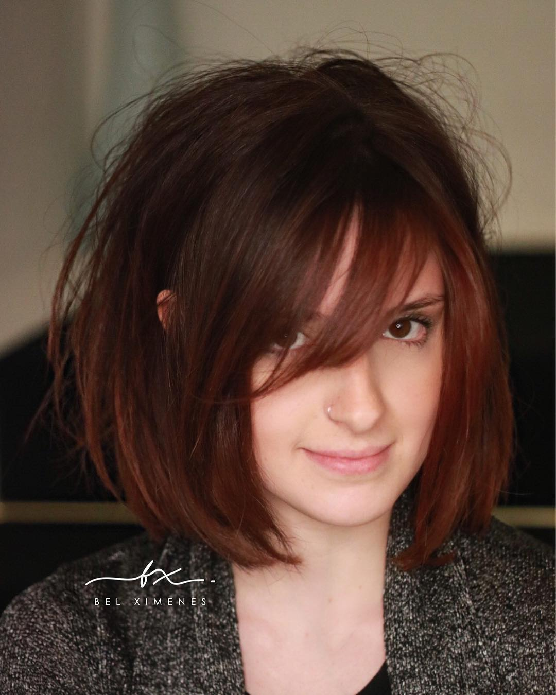 Shaped Bob with Side Swept Bangs and Messy Blowout Texture and Subtle Auburn Balayage Color Medium Length Fall Hairstyle