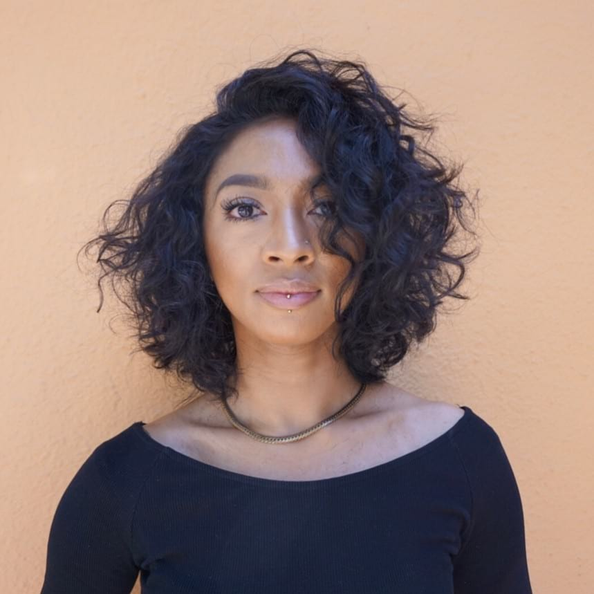 Shaped Textured Bob with Dramatic Side Part and Wavy Curls Medium Length Hairstyle