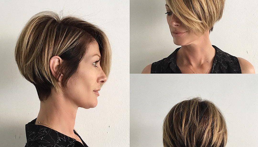 Short Blonde Highlighted Bob with Stacked Layers and Long Side Swept Bangs Short Hairstyle