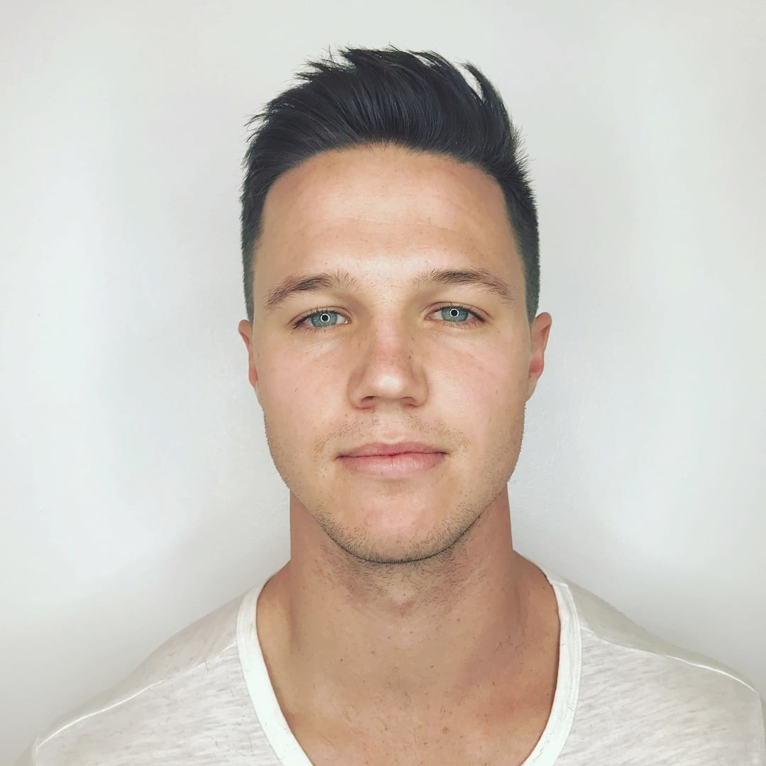 Short Fade Cut with Messy Brushed Up Texture on Black Hair Summer Hairstyle