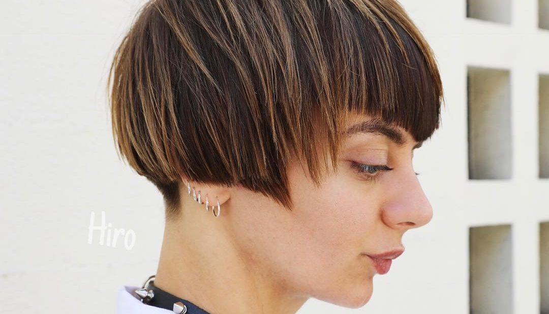 Short Highlighted Brunette Bob with Allover Textured Razor Cut Layers and V Shaped Bangs Short Fall Hairstyle