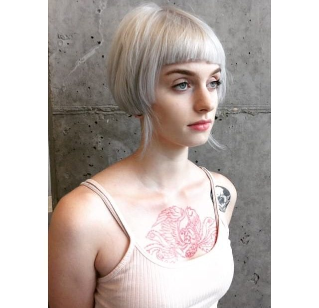 Short Platinum Blonde Eccentric Bob with Blunt Baby Bangs and Wispy Ends Short Fall Hairstyle