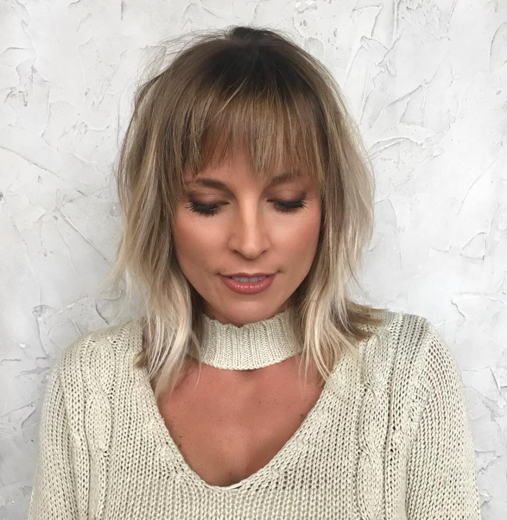 Shoulder Grazing Shaggy Fringe with Messy Wavy Texture and Blonde Lived in Color Hair Painting Medium Length Fall Hairstyle