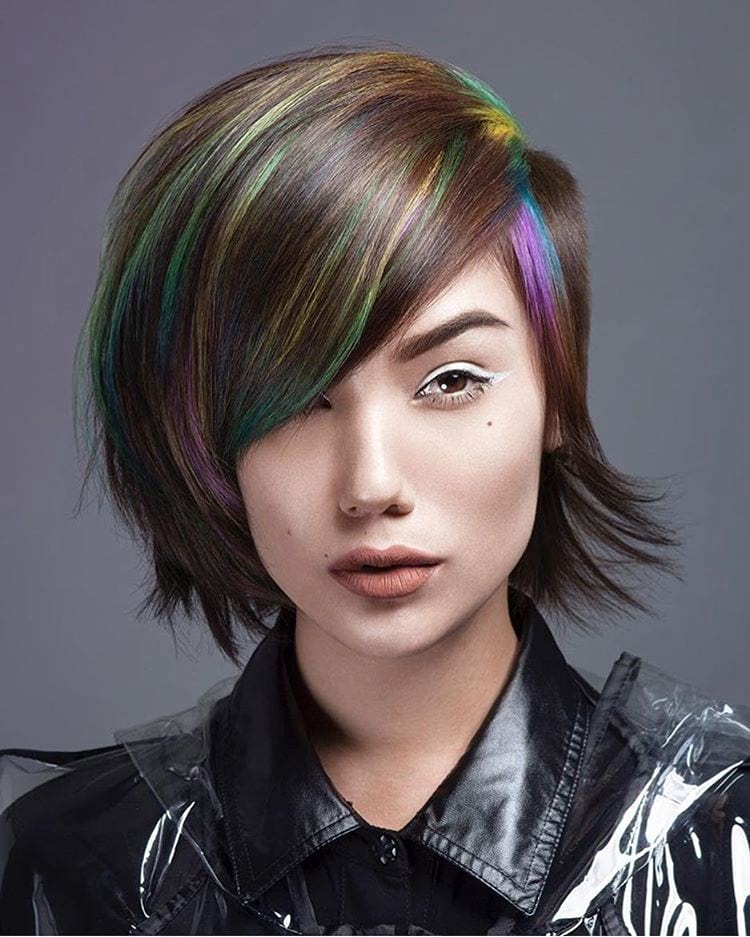 Side-Shaved Undercut Pixie-Bob with Full Side Swept Bangs and Rainbow Highlights