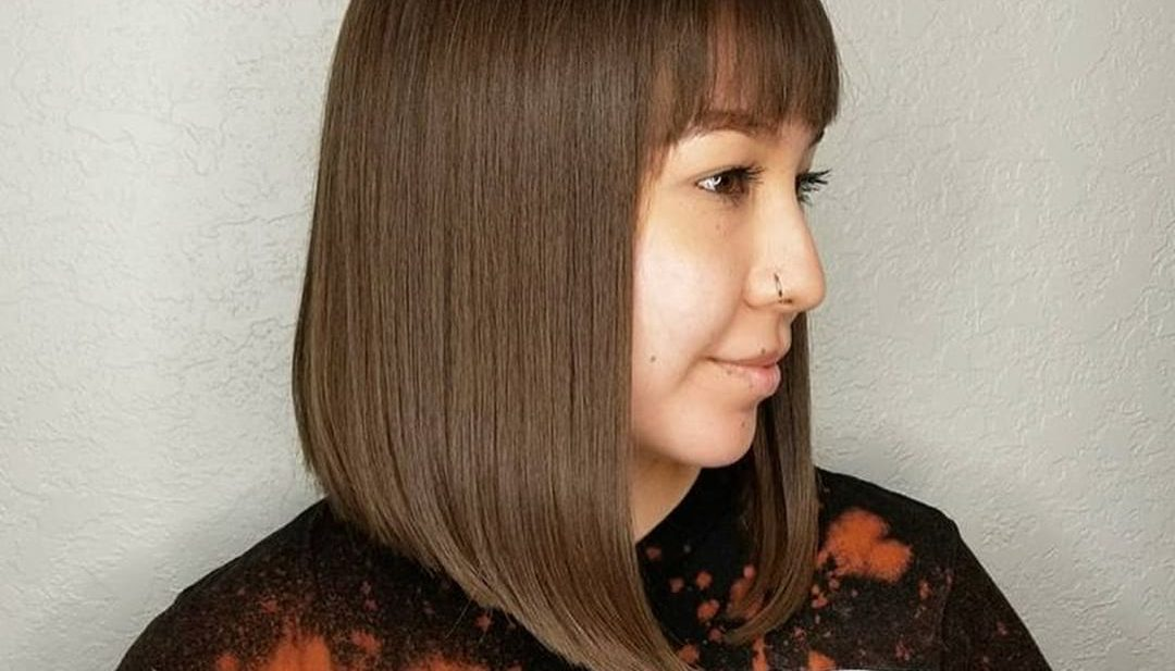 Sleek Angled Lob with Brow Skimming Bangs and Chocolate Brown Hair Color Medium Length Hairstyle