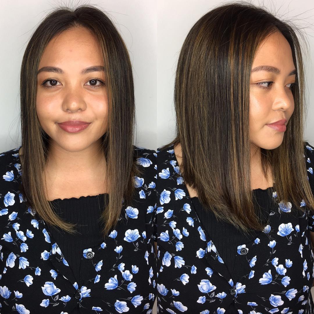 Sleek Angled Lob with Center Part and Caramel Highlights on Dark Hair Medium Length Hairstyle