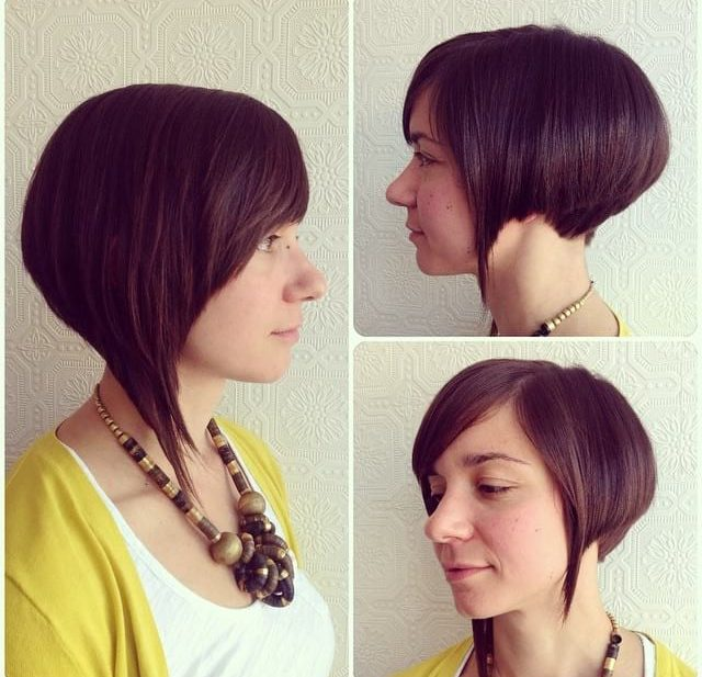 Sleek Asymmetric Angled Bob with Side Swept Bangs and Warm Brunette Color Short Hairstyle