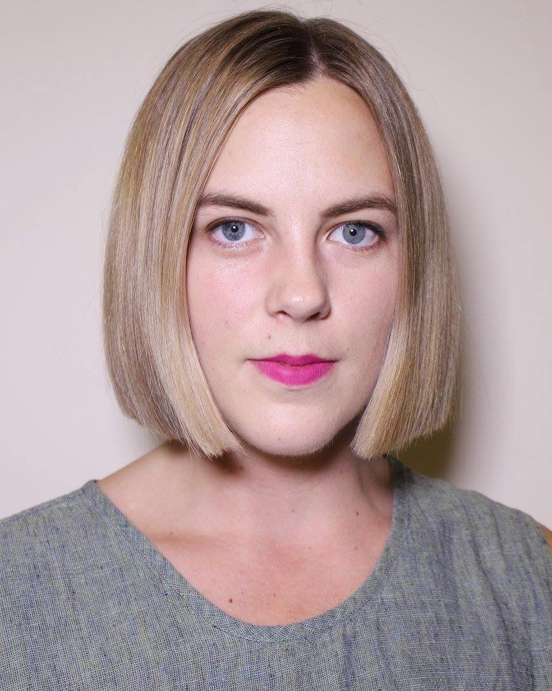 Sleek Blunt Bob with Blonde Color and Subtle Highlights Medium Length Hairstyle