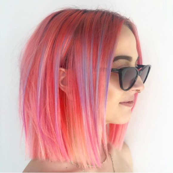 Sleek Blunt Bob with Pink Fruit Punch Hair Color and Pastel Purple Highlights Medium Length Hairstyle