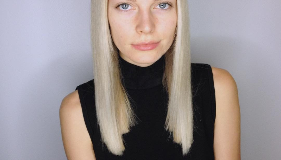 Sleek Blunt Cut with Center Part and Subtle Platinum Blonde Balayage Long Hairstyle