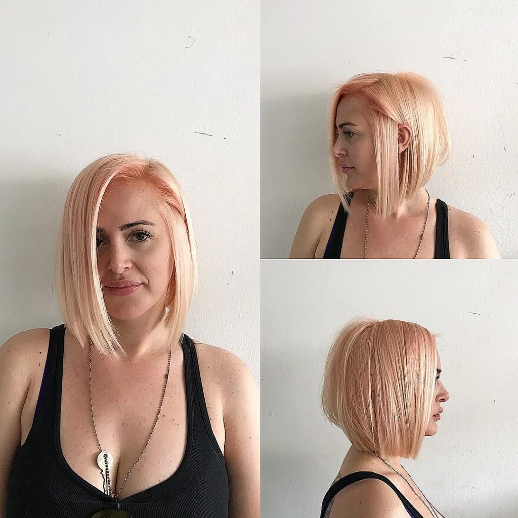Sleek Bob with Clean Lines and Soft Rose Gold Blonde Color Medium Length Hairstyle