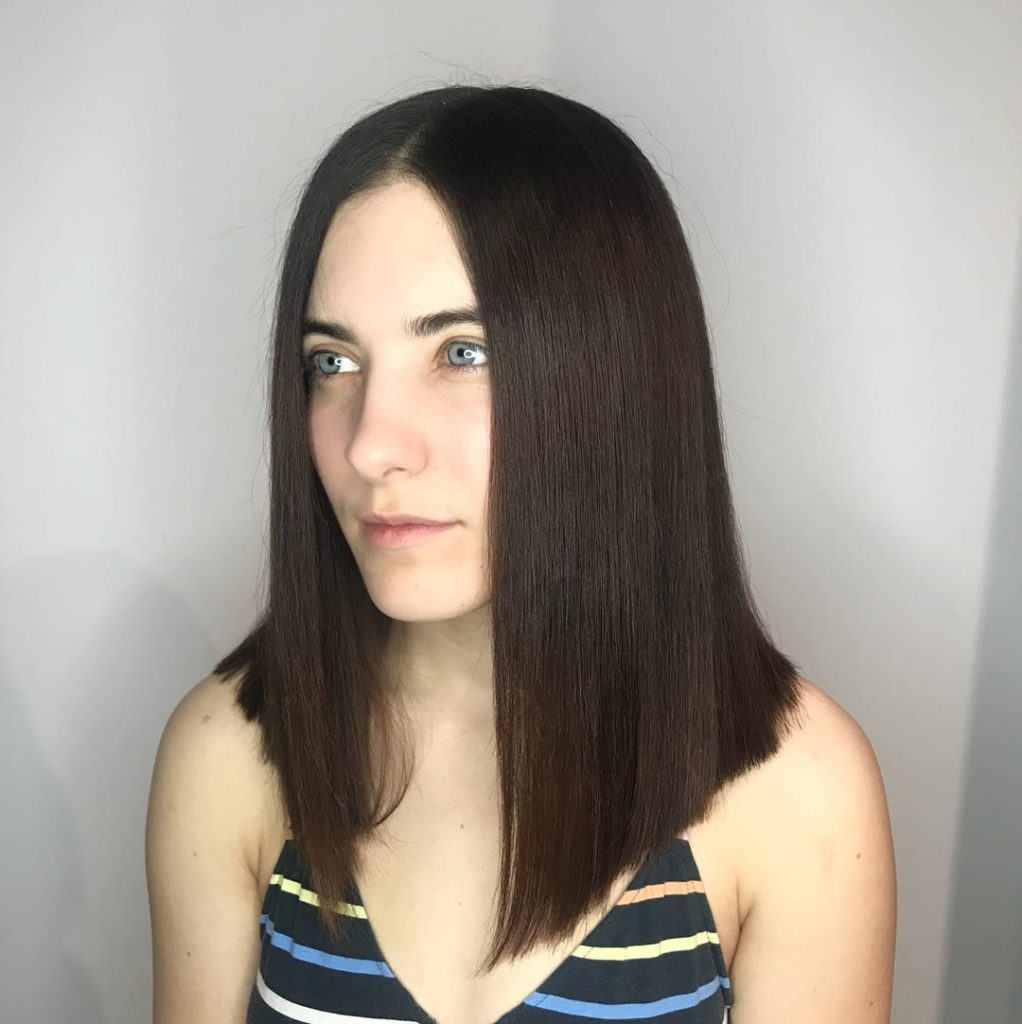 Sleek Brunette Lob with Sharp Blunt Angle and Center Part Medium Length Hairstyle