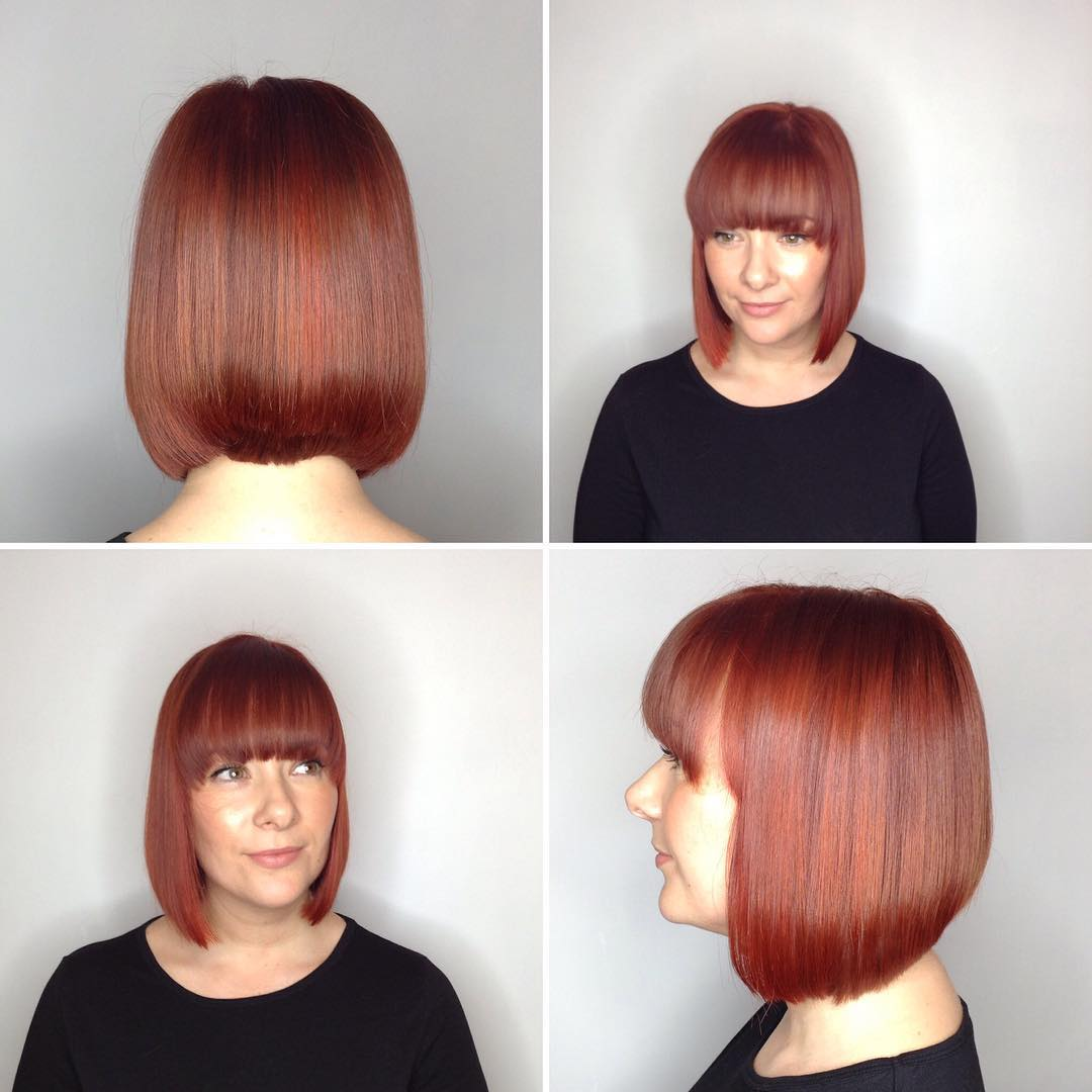 Sleek Collapsed Bob with Full Brow Skimming Bangs and Rich Auburn Color Medium Length Hairstyle