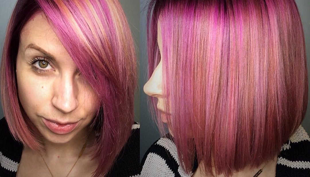 Sleek Peachy Pink Highlighted Bob with Side Swept Bangs Medium Length Hairstyle