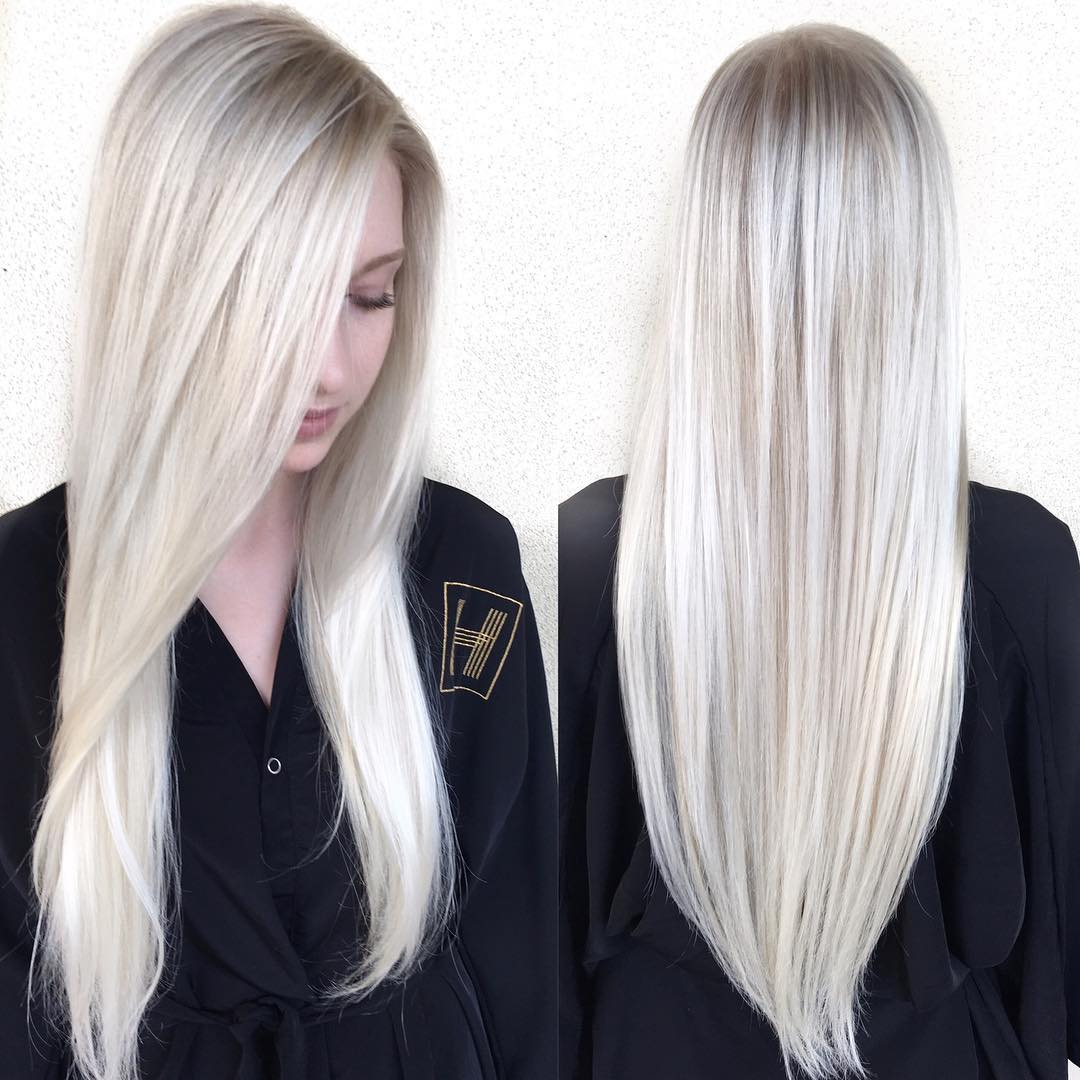 Sleek Platinum Blonde Hair with Side Part and V-Cut Layers Long Hairstyle