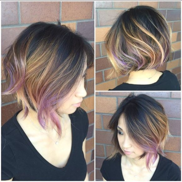 Slightly Angled Blowout Bob on Dark Hair with Caramel and Rose Highlights Medium Length Hairstyle