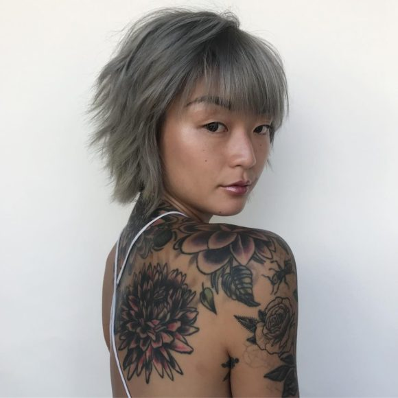 Smoky Grey Choppy Pixie Bob with Messy Texture and Brow Skimming Bangs Short Fall Hairstyle