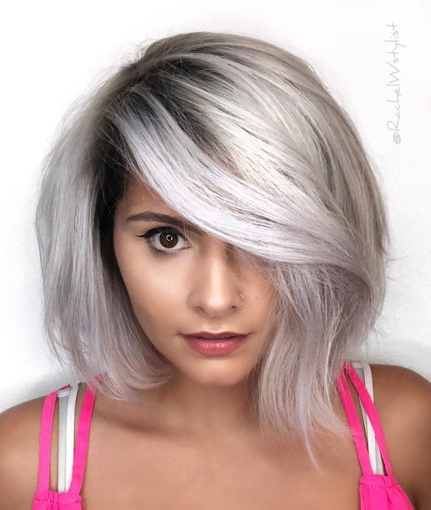 Smoky Silver Platinum Asymmetric Bob with Long Side Swept Bangs and Blowout Texture Medium Length Fall Hairstyle