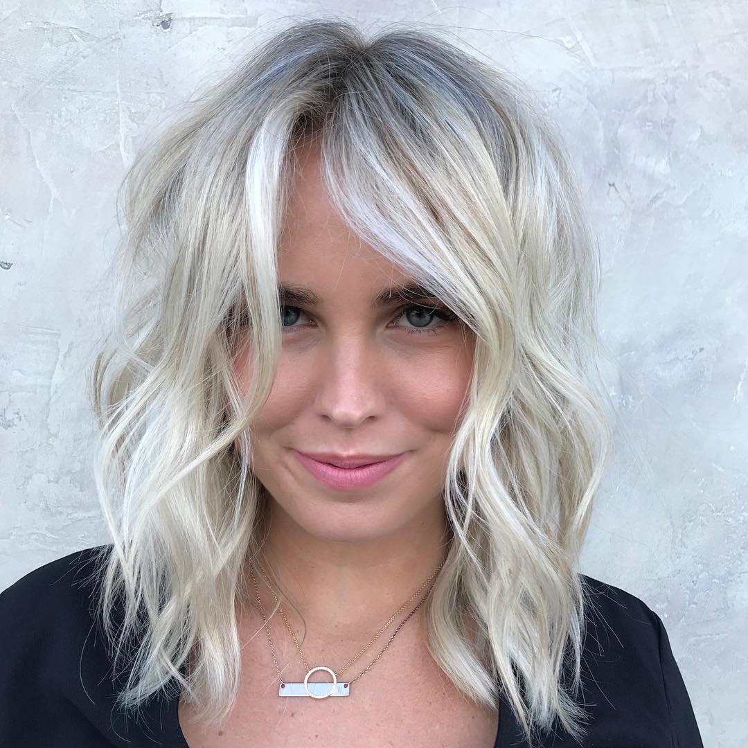 Soft Blonde Lob with Undone Textured Waves and Babylights Medium Length Hairstyle