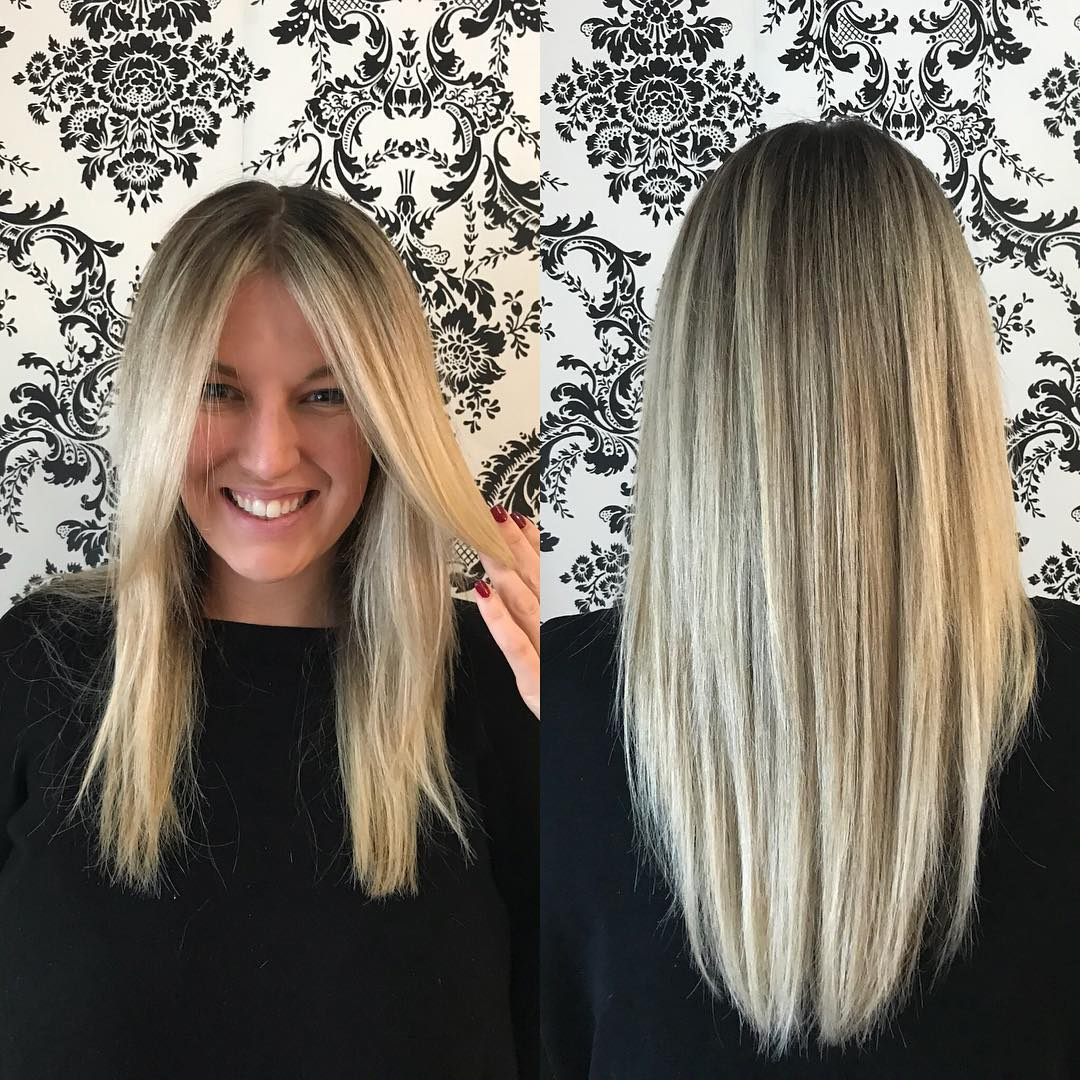 Soft Layered Cut with Straight Texture and Long Curtain Bangs on Blonde Balayage Highlighted Hair Long Hairstyle