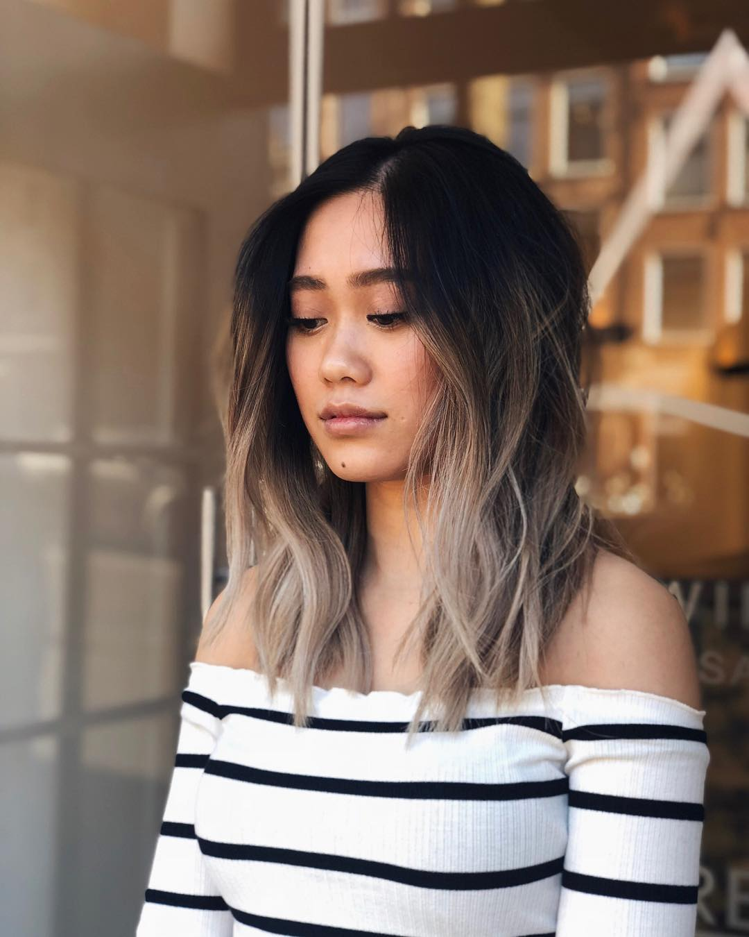 Soft Layered Lob with Soft Waves and Black to Ash Blonde Color Melt Medium Length Hairstyle