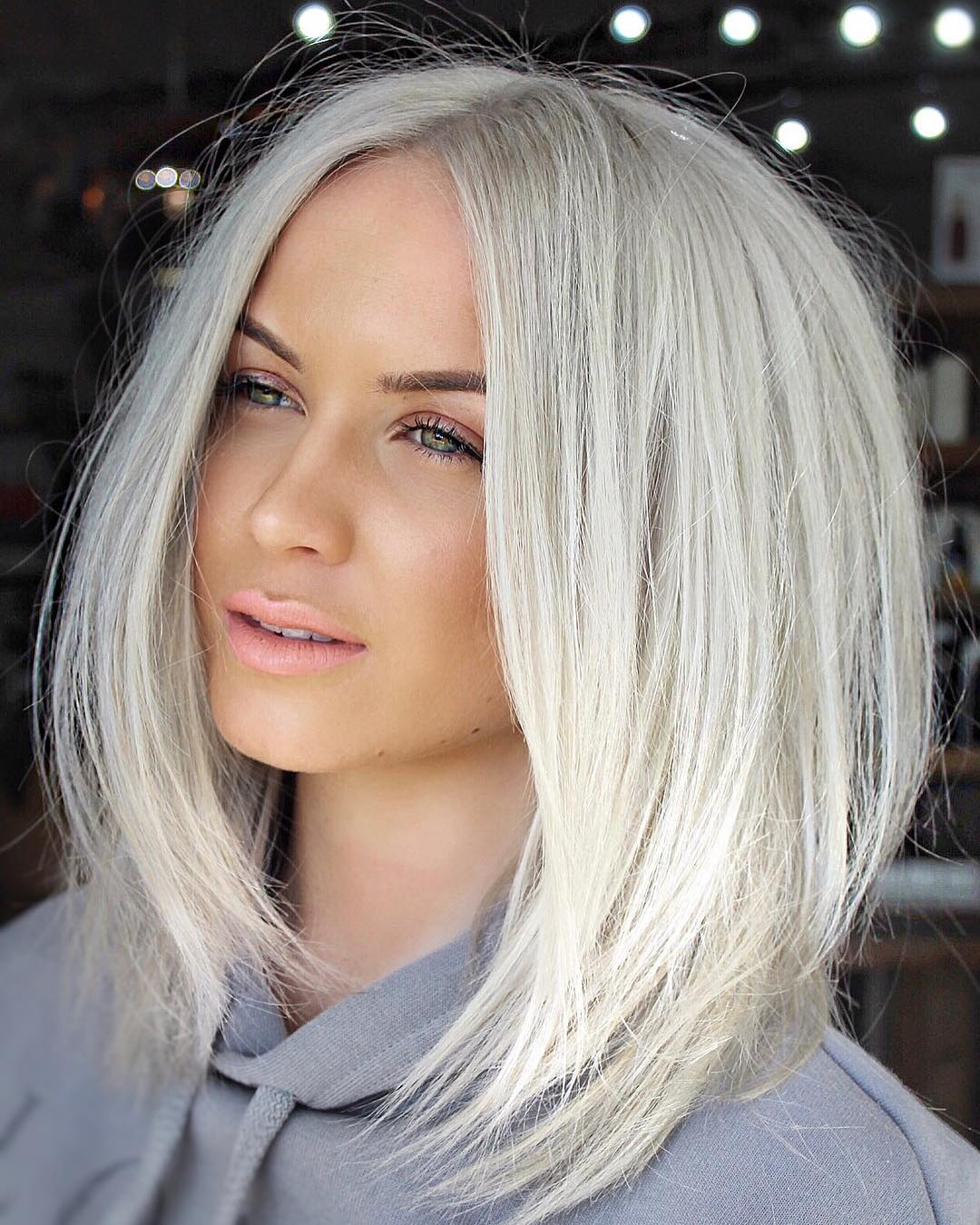 Soft Layered Platinum Lob with Messy Blowout Straight Texture and Center Part Medium Length Summer Hairstyle