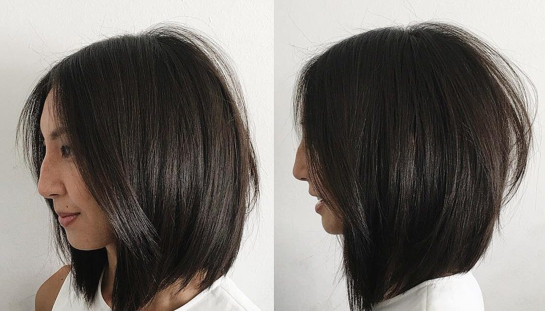 Soft Layered Undercut Bob with Curtain Part and Straight Texture Medium Length Hairstyle