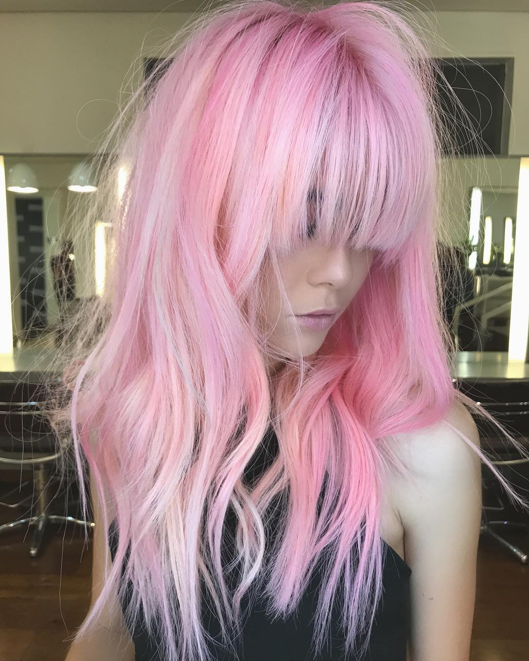 Soft Pink Textured Wavy Layered Cut with Brow Skimming Fringe Bangs Long Hairstyle