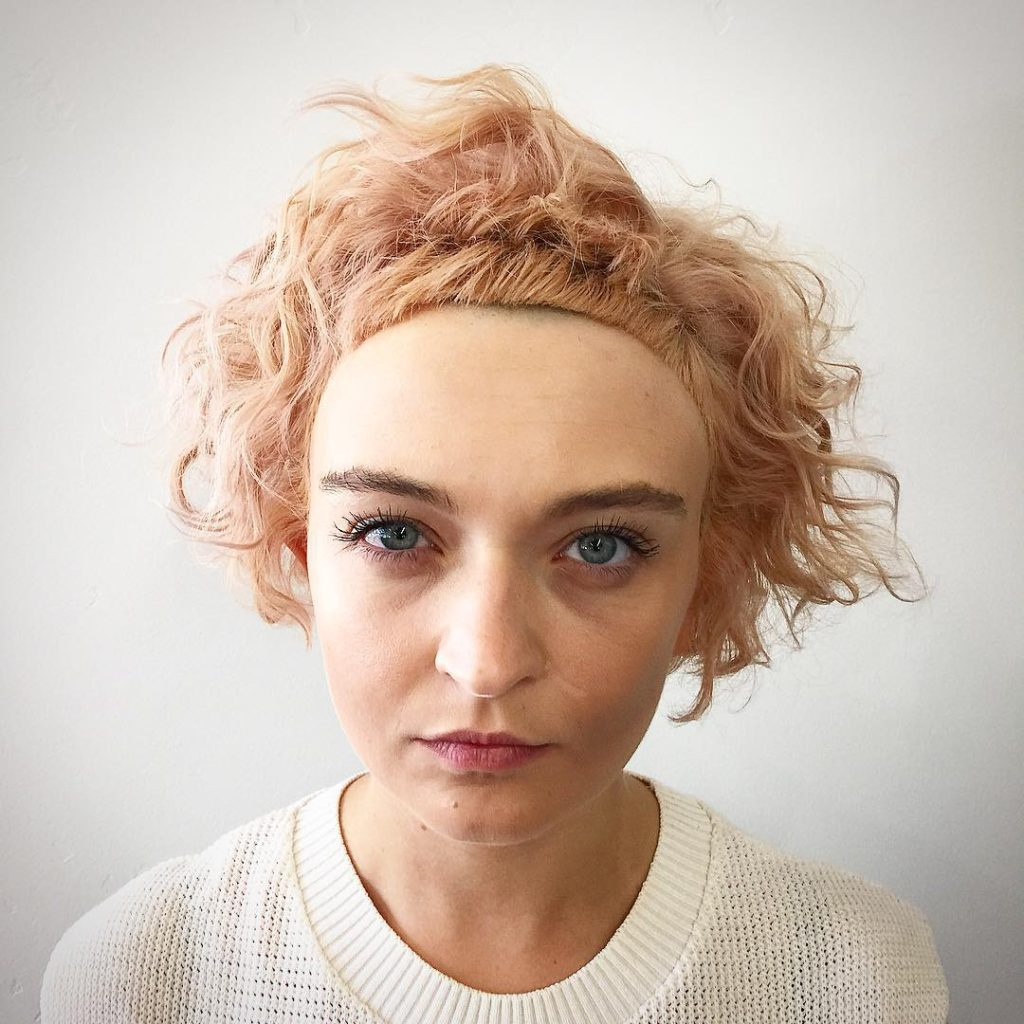 Soft Rose Gold Bob with Undone Curly Fringe and Micro Bangs Short Hairstyle