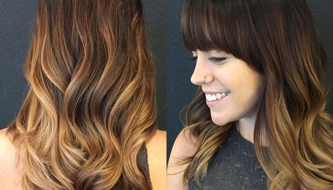 Soft Wavy Layered Cut with Brunette Color Melt Balayage and Full Brow Skimming Bangs Long Hairstyle