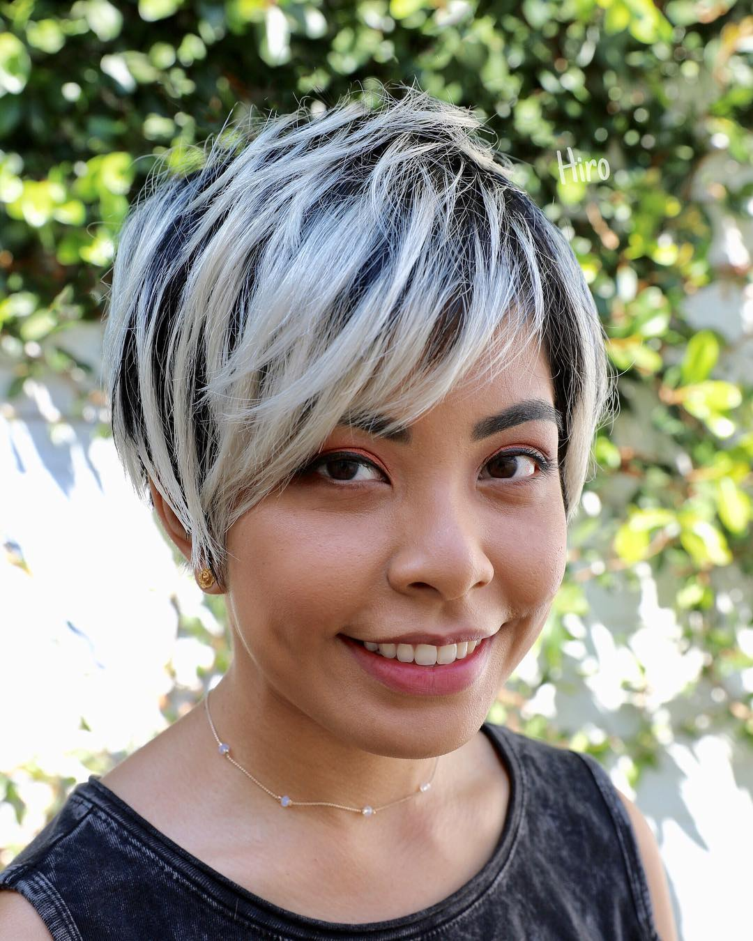 Textured Long Layered Pixie with Asymmetrical Side Swept Bangs and Platinum Blonde Highlights on Black Hair Short Summer Hairstyle