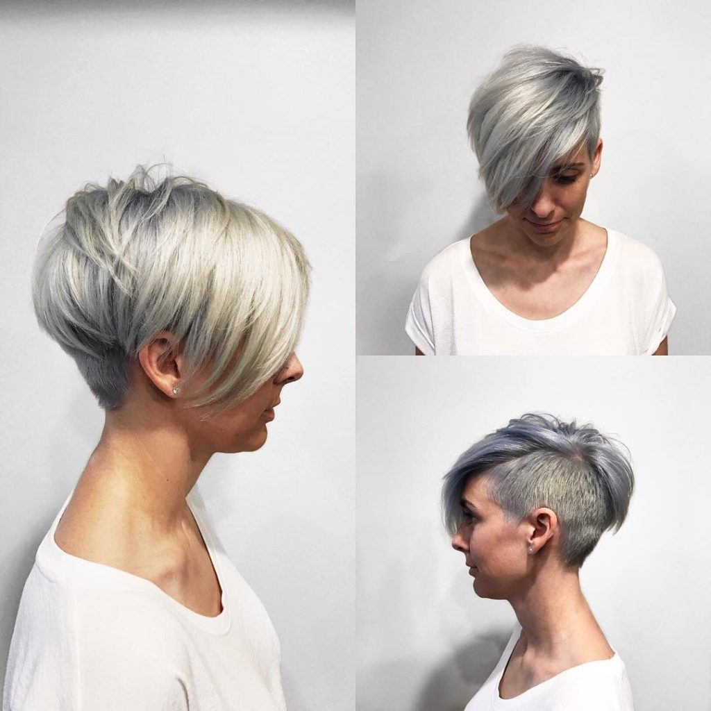 Textured Platinum Undercut Pixie with Long Side Swept Bangs and Metallic Silver Shadow Roots