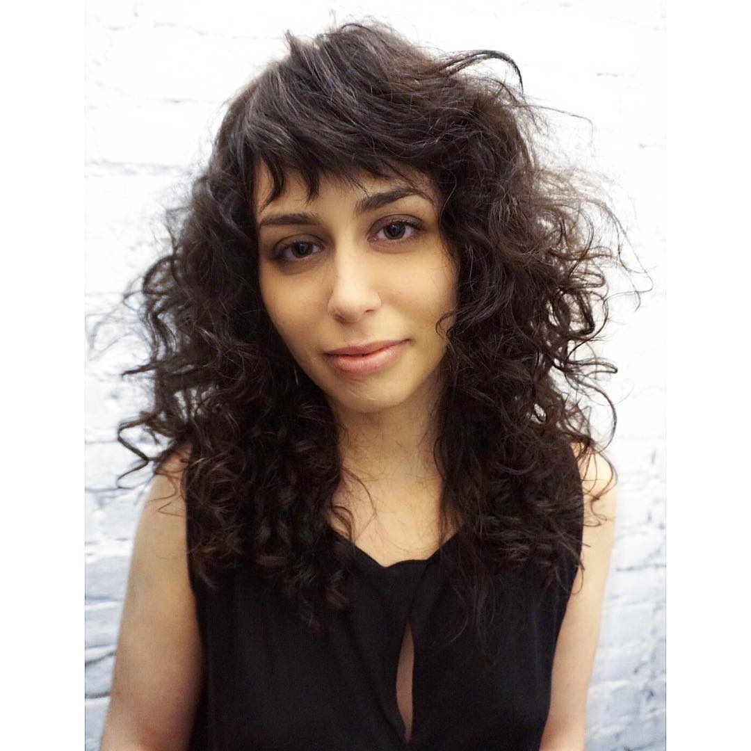 Undone Curly Shag Cut with Fringe Bangs and Brunette Color Long Hairstyle