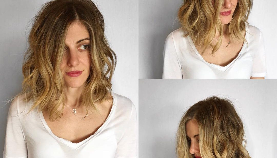 Undone Layered Lob with Textured Waves and Blonde Balayage Medium Length Hairstyle