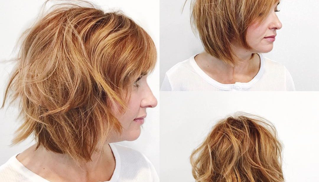 Undone Razor Cut Bob with Side Swept Bangs and Light Auburn Color with Highlights Medium Length Hairstyle