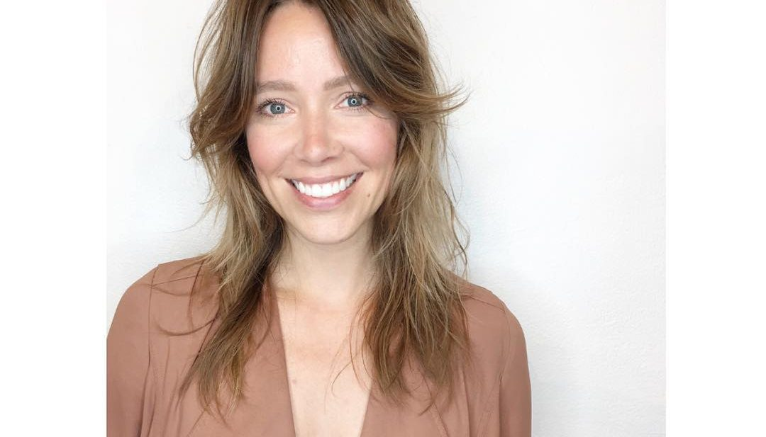 Undone Shaggy Razor Cut with Curtain Bangs and Soft Golden Balayage Long Hairstyle