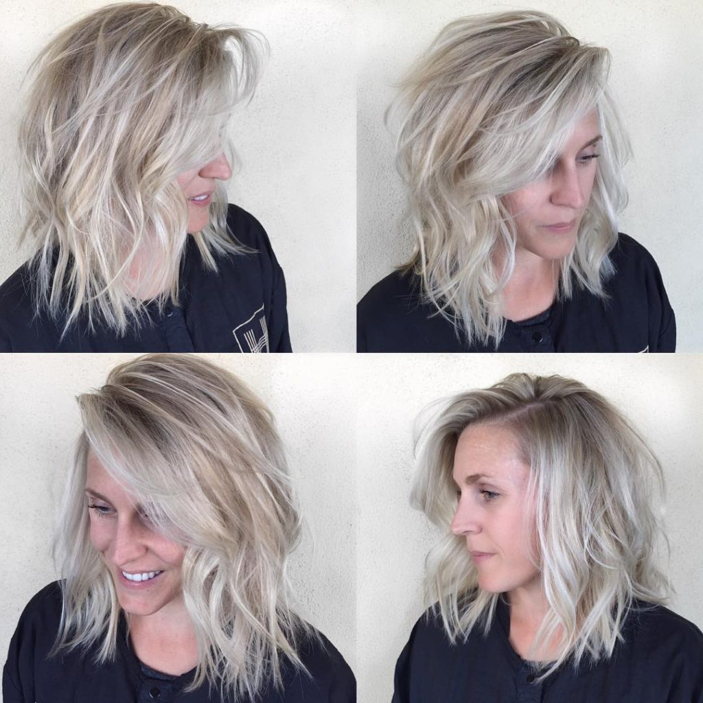Undone Textured Lob with Long Side Swept Bangs and Pale Blonde Balayage Medium Length Hairstyle