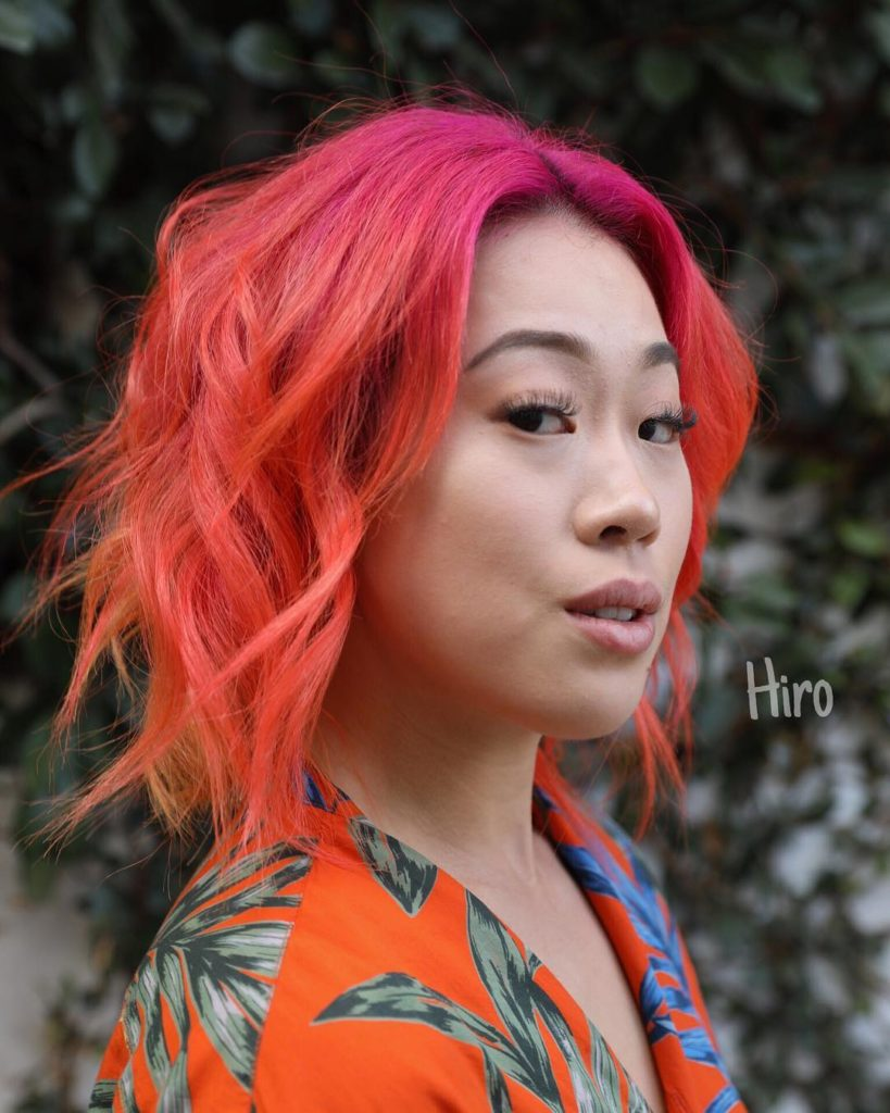 Undone Wavy Layered Bob with Curtain Bangs and Fiery Neon Ombre Color Medium Length Hairstyle