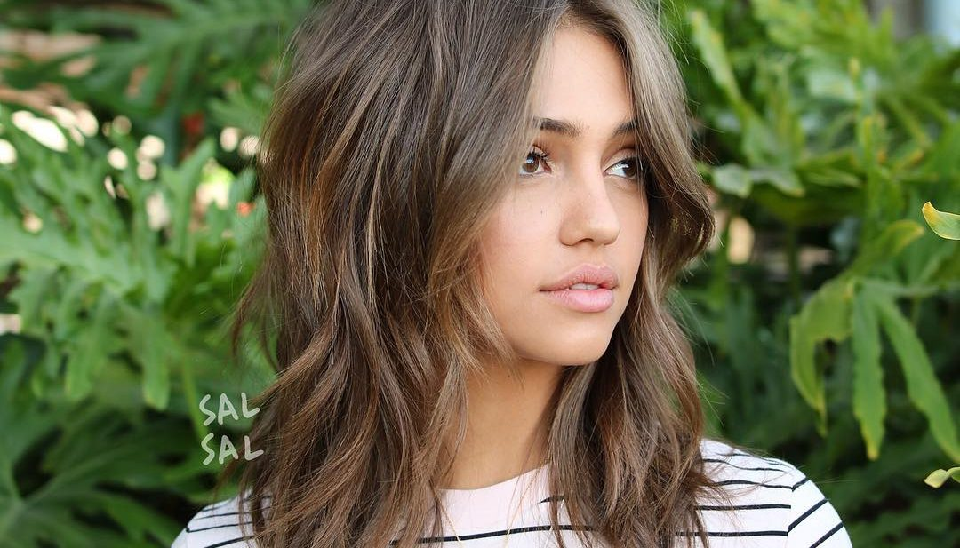 Undone Wavy Shag with Long Curtain Bangs and Soft Ash Brown Balayage with Bronze Highlights Medium Length Hairstyle