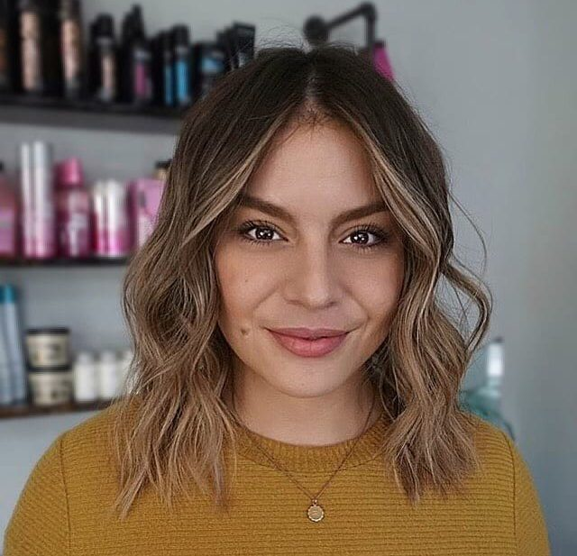 Undone Wavy Textured Bob with Blonde Balayage and Center Part Medium Length Hairstyle