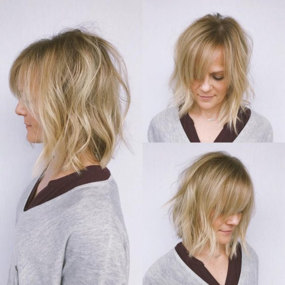 Undone Wavy Textured Bob with Parted Side-Swept Bangs and Blonde Balayage Medium Length Hairstyle